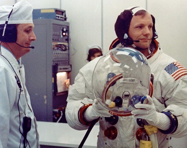 Apollo 11 Commander Neil Armstrong prepares to don his helmet on launch day.