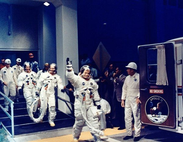 Armstrong leads the crew from the Manned Spacecraft Operations Building to the transfer van.