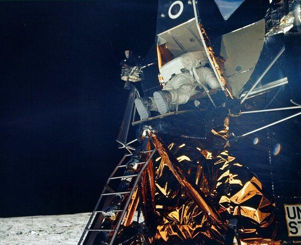 Buzz Aldrin exits the lunar module.