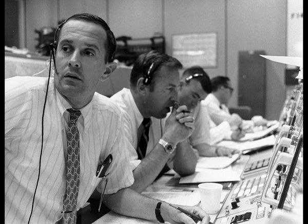 Flight controllers during lunar module descent.