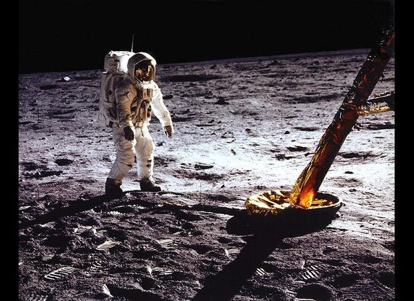 Aldrin stands beside the lunar module strut.