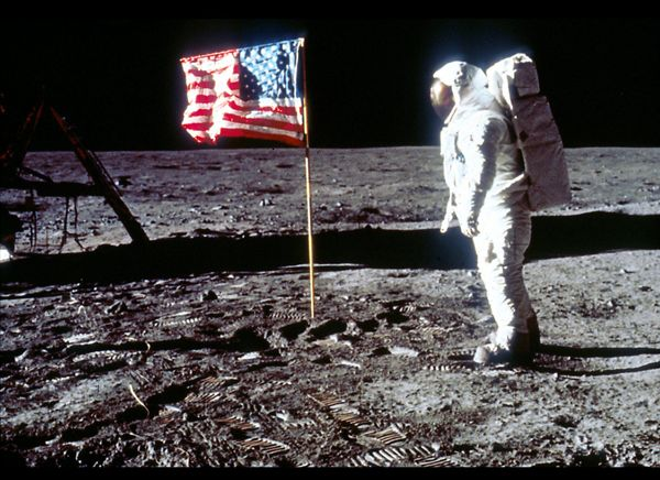 Aldrin poses next to the U.S. flag on the moon.