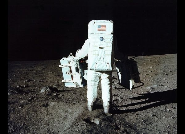 Aldrin carries experiments for deployment.