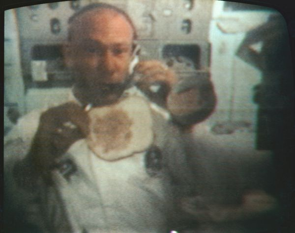 Aldrin shows his Earth-bound television audience how to make a sandwich in space during his journey home from the moon. When