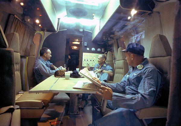The Apollo 11 crew relaxes in the quarantine van.