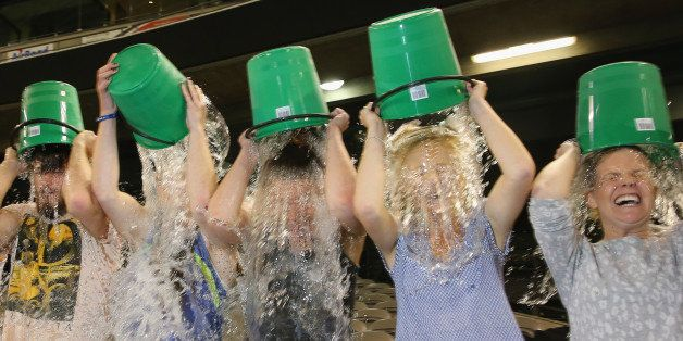 MELBOURNE, AUSTRALIA - AUGUST 22:  Participants tip buckets of ice water over their heads as they take part in the World Reco