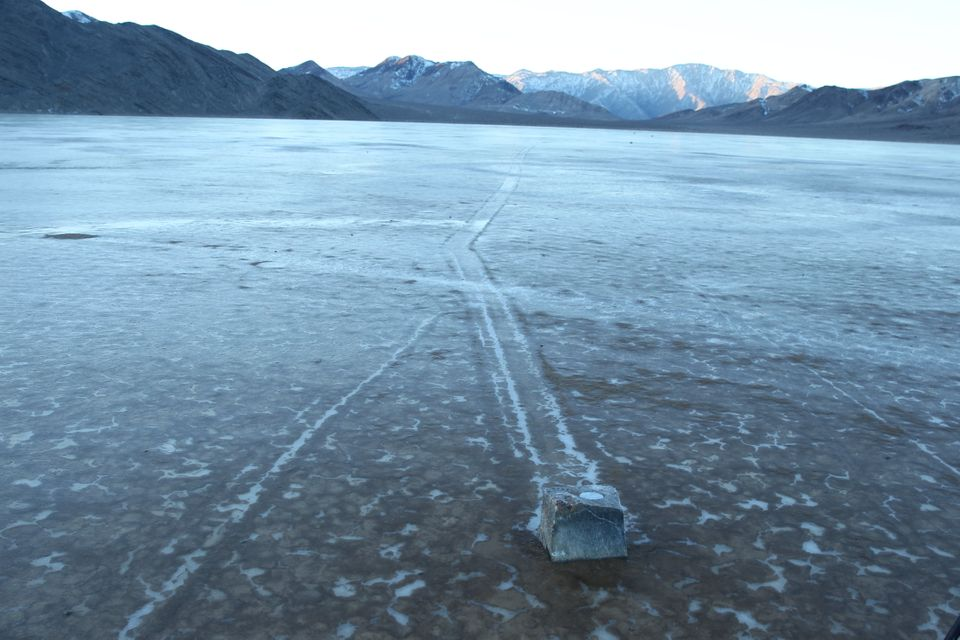 One of the GPS rocks with its trail on a cold morning when the pond surface is still covered with ice.