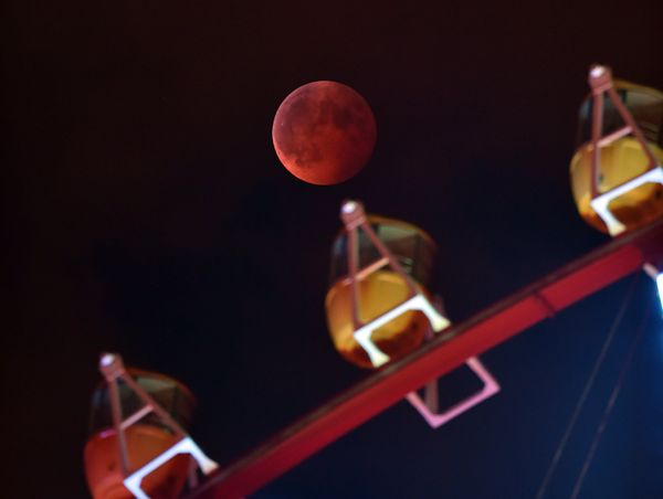 The eclipse from behind a ferris wheel in Tokyo.