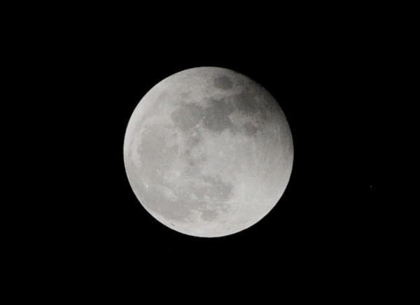 A full moon hangs in the sky after the eclipse, in Quezon City, suburban Manila.