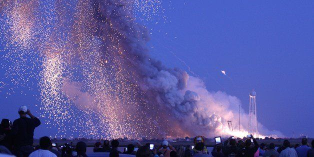 An unmanned rocket owned by Orbital Sciences Corporation explodes October 28, 2014 just seconds after launch from Wallops Isl