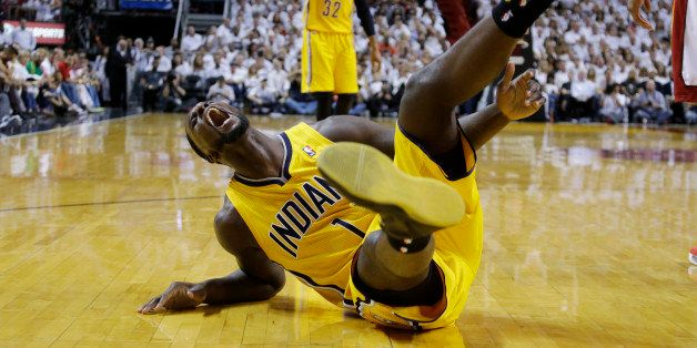 Indiana Pacers guard Lance Stephenson (1) yells after he fell hard following a foul from Miami Heat center Chris Bosh during