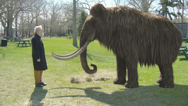 Dr. George Church, a molecular geneticist at Harvard, with a GGI reconstruction of a woolly mammoth.