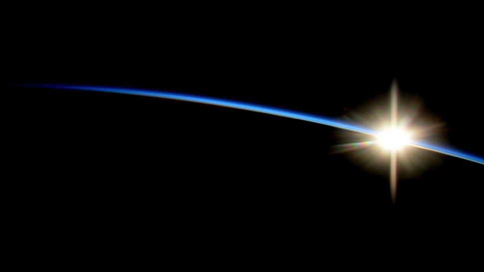 """ISS astronaut Reid Wiseman tweeted this image of a <a href=""""http://www.nasa.gov/content/sunrise-from-the-international-space-"""