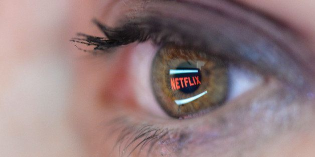 PARIS, FRANCE - SEPTEMBER 19:   In this photo illustration the Netflix logo is reflected in the eye of a woman on September 1