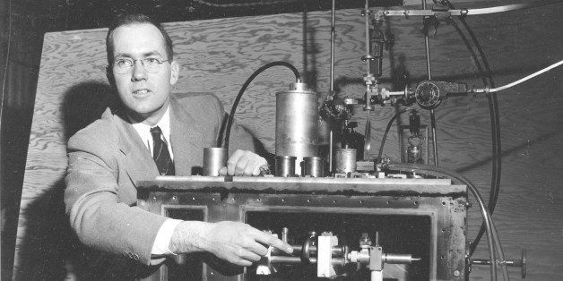 Charles H. Townes, Columbia University professor and Nobel Laureate, explains his invention the maser during a news conferenc