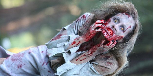 Zombie woman scratches her face, wide shot
