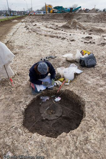 Archaeologists searching the contents of the tomb.