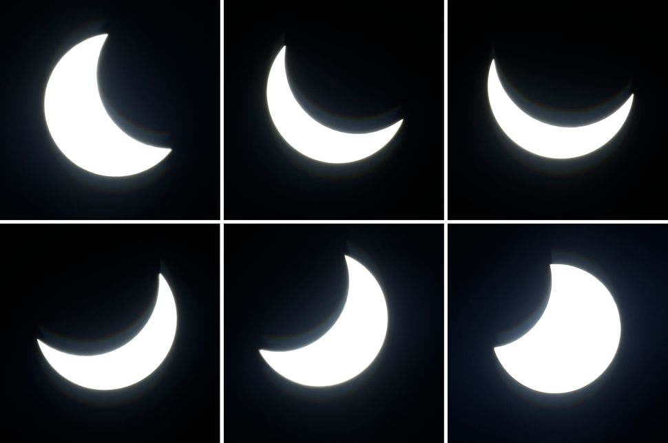 The moon crossing in front of the sun during the solar eclipse as seen from Berlin, Germany.