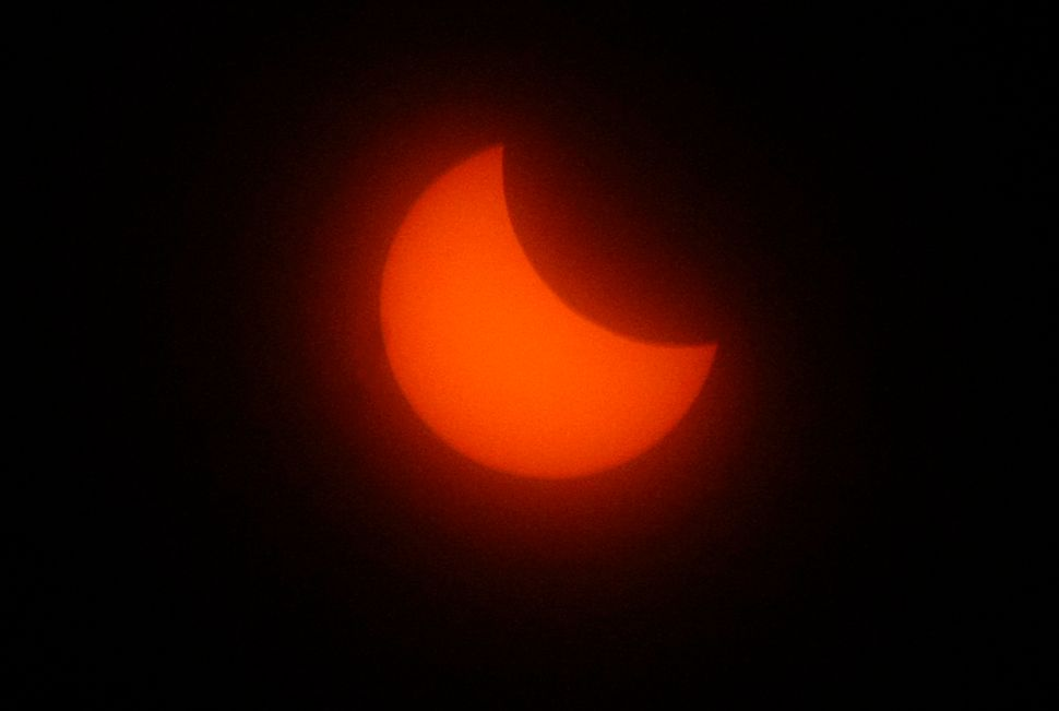 The sun is seen during the solar eclipse in Marseille, southern France.