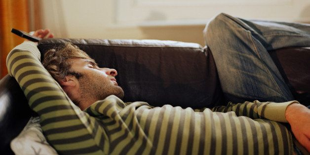 Man asleep on sofa, close-up