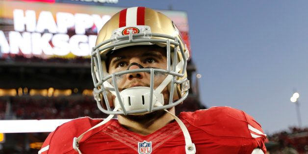 SANTA CLARA, CA - NOVEMBER 27: Chris Borland #50 of the San Francisco 49ers stands on the field prior to the game against the