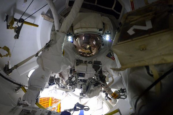 "My very first ""steps"" outside, going down through the airlock hatch. #USEVA29 #spacewalk"