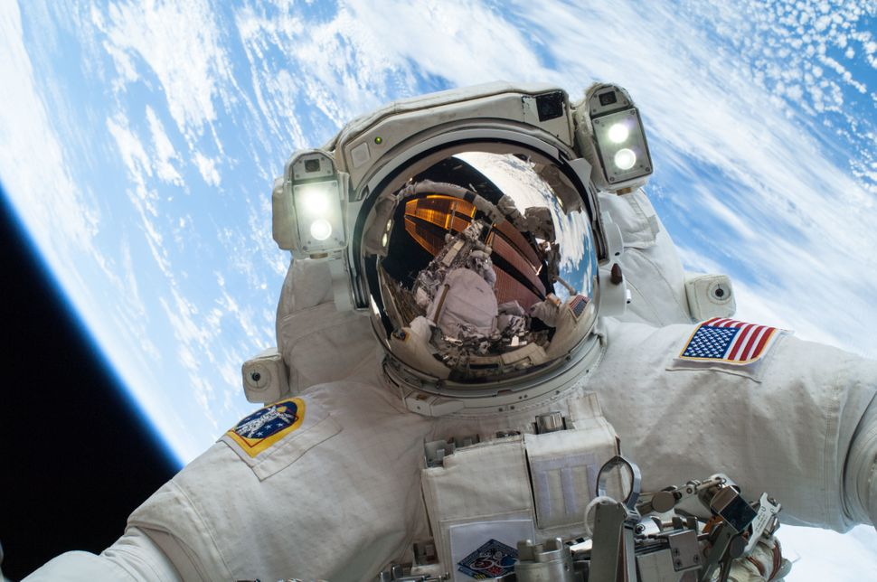 NASA astronaut Mike Hopkins snapped a selfie while completing a spacewalk outside of the Earth-orbiting International Space S