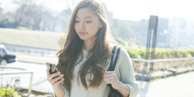Young woman using smartphone on