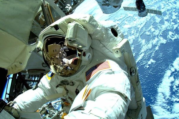 Out on the P3 truss. #AstroButch handing me his cable to install on the new antenna. #spacewalk