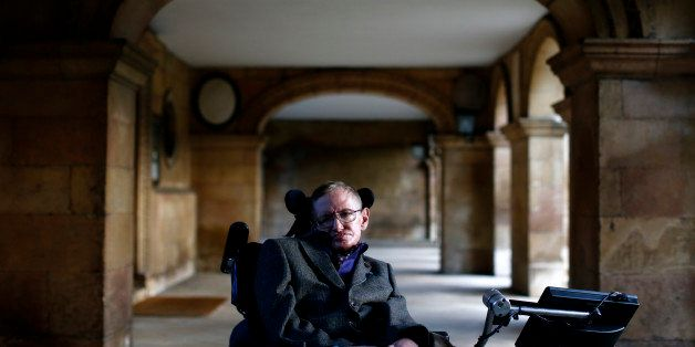 Theoretical physicist Stephen Hawking poses for a picture ahead of a gala screening of the documentary film 'Hawking', a film
