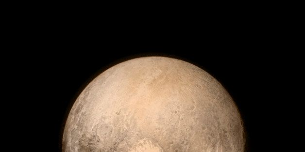IN SPACE - JULY 14:  In this handout provided by the National Aeronautics and Space Administration (NASA), Pluto nearly fills