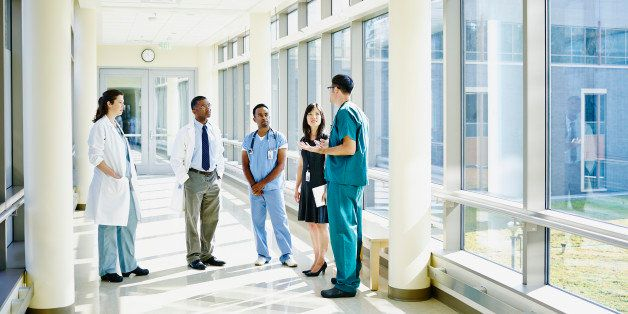 Medical team in discussion in hospital corridor