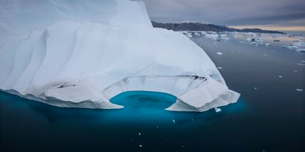 FILE - In this July 19, 2007 file photo, an iceberg is seen melting off the coast of Ammasalik, Greenland.  A new assessment