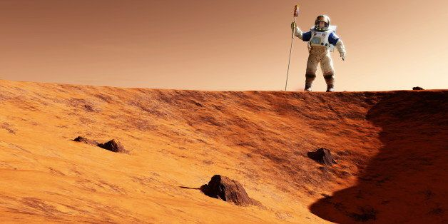 Astronaut on Mars. Artwork of an astronaut holding experimental equipment standing on the edge of a Martian crater. The Marti