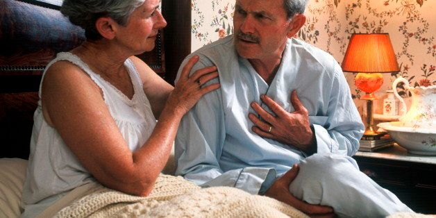 UNITED STATES - 2009/05/18: Senior man with chest pain is comforted by his concerned wife. (Photo by John Greim/LightRocket v