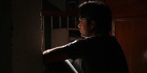 Man sitting in doorway
