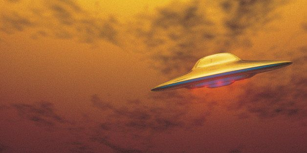 UFO Flying Through Yellowish Sky