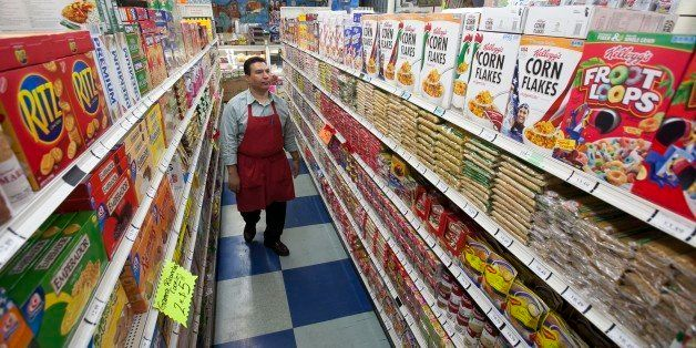 In this photo taken Thursday, Nov. 1, 2012, Grocery market owner Ray Martinez poses for a photo at La Playa Market in Inglewo