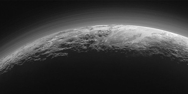 This July 14, 2015 photo released by NASA on Thursday, Sept. 17, 2015 shows the atmosphere and surface features of Pluto, lit