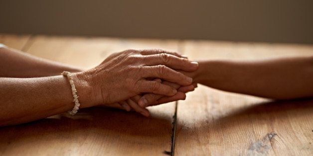 A cropped shot of a woman holding a loved one's hand in supporthttp://195.154.178.81/DATA/i_collage/pi/shoots/783366.jpg