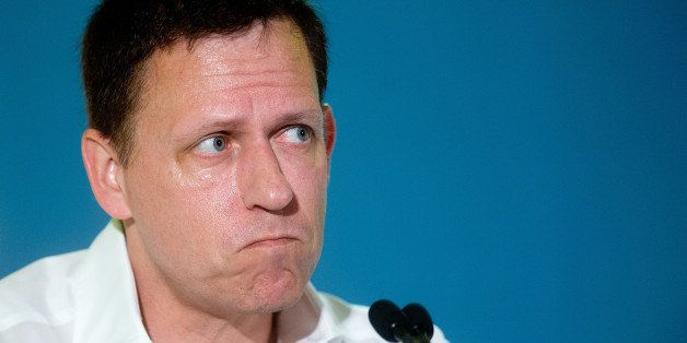 Peter Thiel, head of Clarium Capital Management LLC and founding investor in PayPal Inc. and Facebook Inc., listens during th
