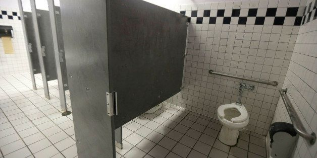 A disabled toilet stall is shown in the boys bathroom where police were investigating reports of a brutal assault of a transg