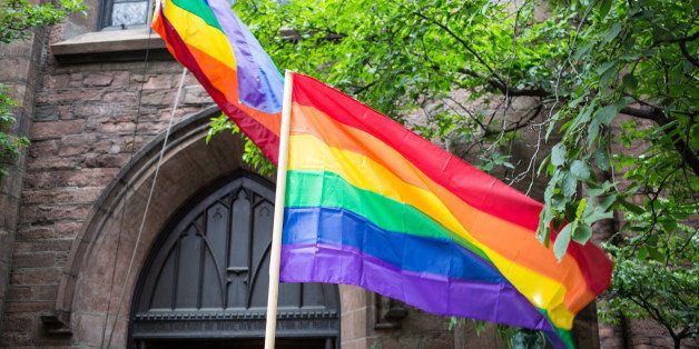 Rainbow flags proudly displayed at the church of ascention in manhattan on 5th avenue.