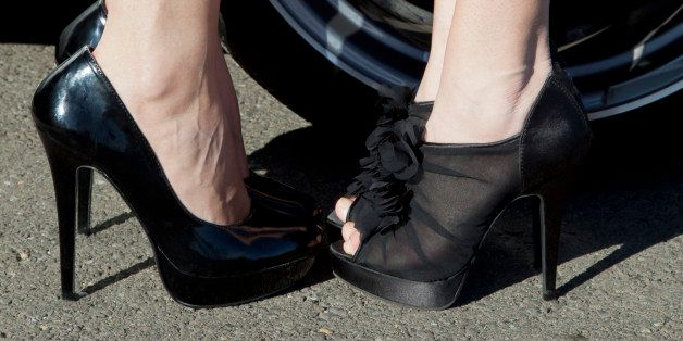Two girls facing each other toe to toe.