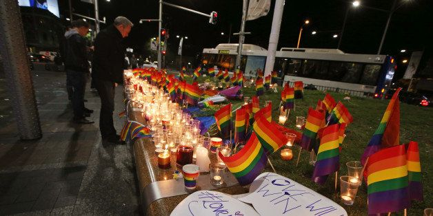 An impromptu memorial is set up in Sydney, Monday, June 13, 2016, following the Florida mass shooting at the Pulse Orlando ni
