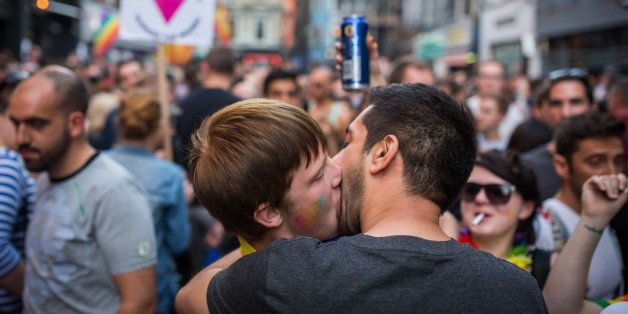 LONDON, ENGLAND - JUNE 27:  Men kiss in Soho following the annual Pride in London Parade on June 27, 2015 in London, England.