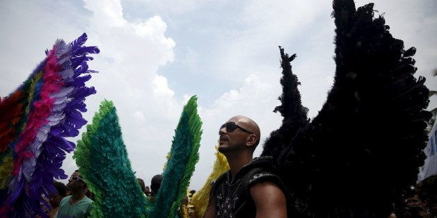 Revellers take part in a LGBT Pride Parade in Copacabana beach in Rio de Janeiro, Brazil, November 15, 2015. REUTERS/Pilar Ol