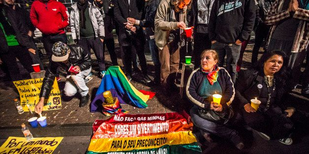 SAO PAULO, BRAZIL - JUNE 12:  People and members of the gay community gather for a vigil near the Sao Paulo Museum of Art to