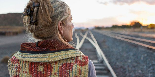 Caucasian woman standing on train tracks