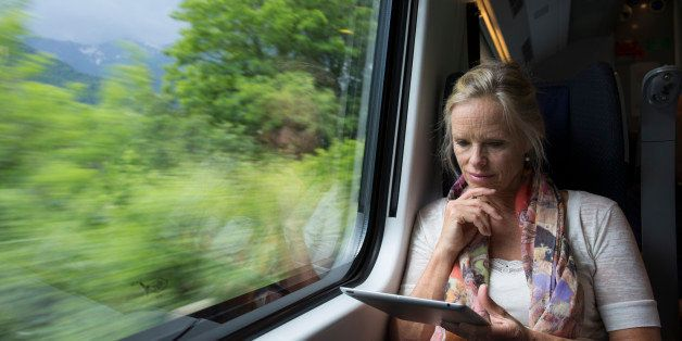 Woman uses digital tablet on board speeding train